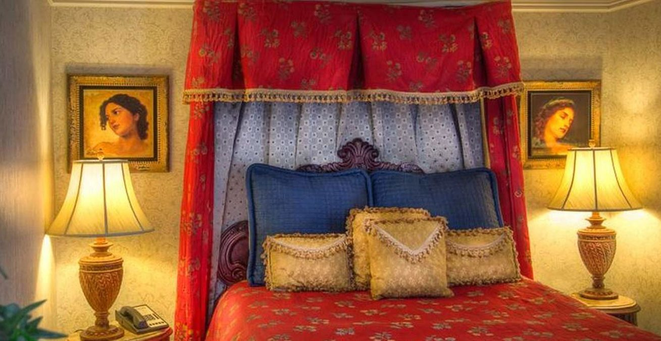 Guest bedroom with red bedding